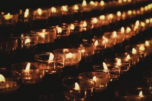 The light of candles makes God seem apparent